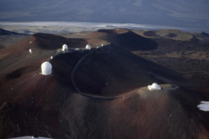 A cluster of observatories stand around Mauna Kea volcano